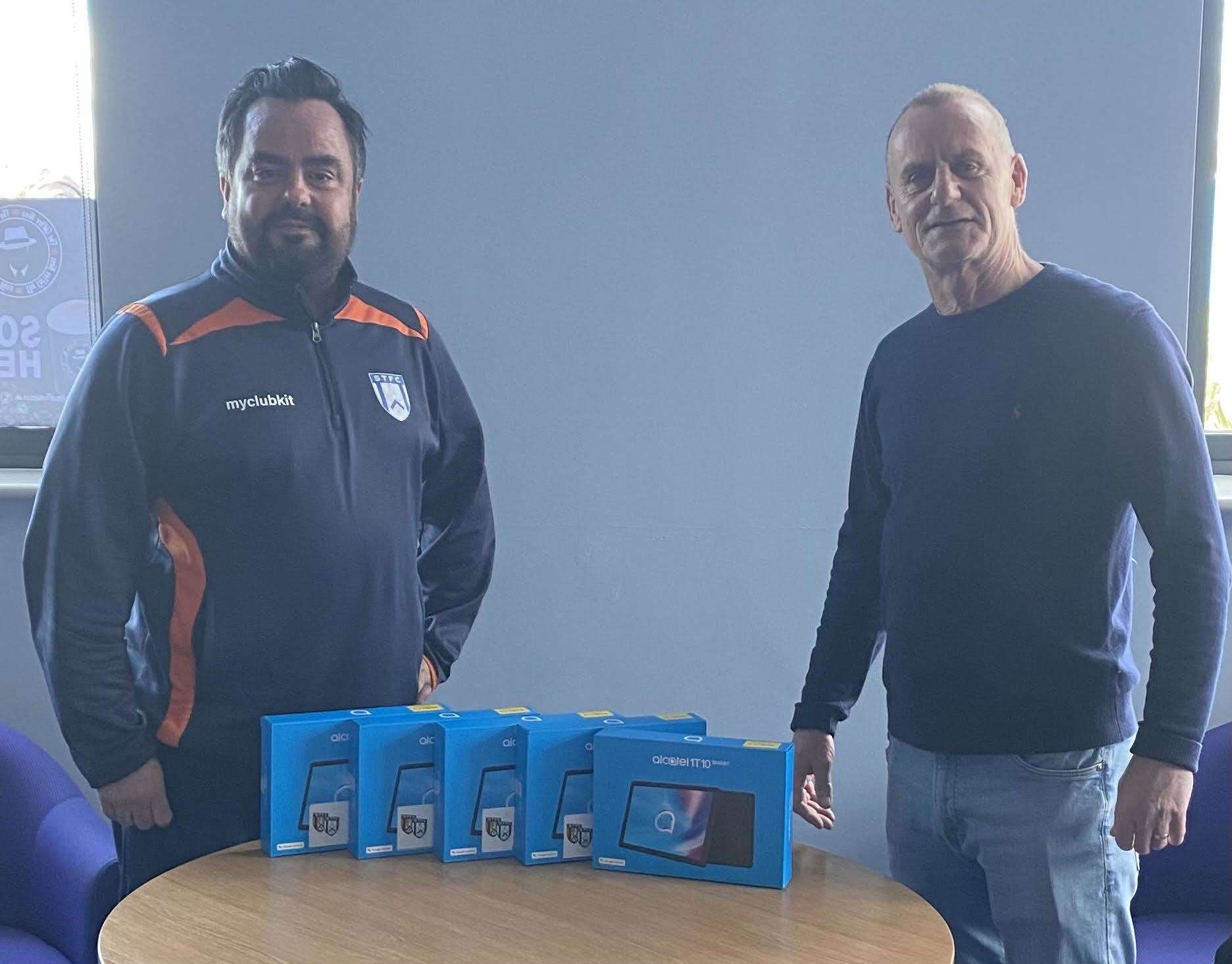 Steven Burge, commercial manager at STFC, and Chris Simpson, chairman of the club's supporters' association, pictured with the new tablets that will go to five students of the club's academy.
