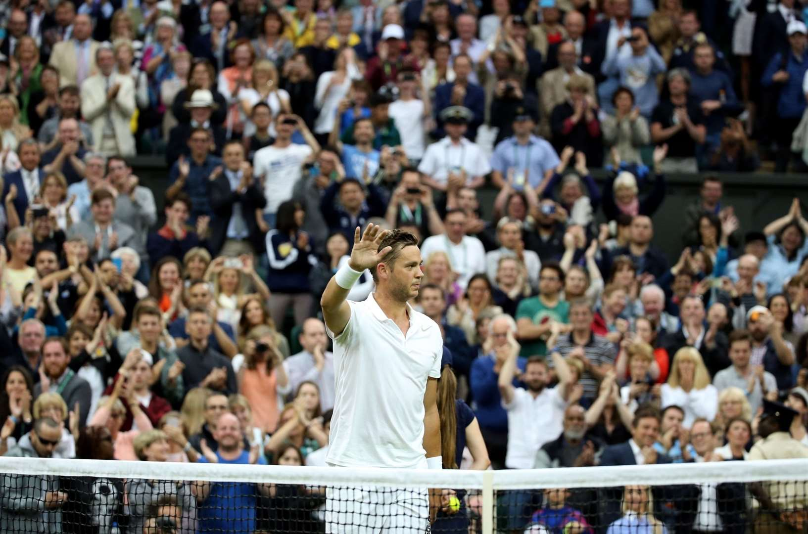 Marcus Willis acknowledges the crowd following his defeat to Roger Federer.