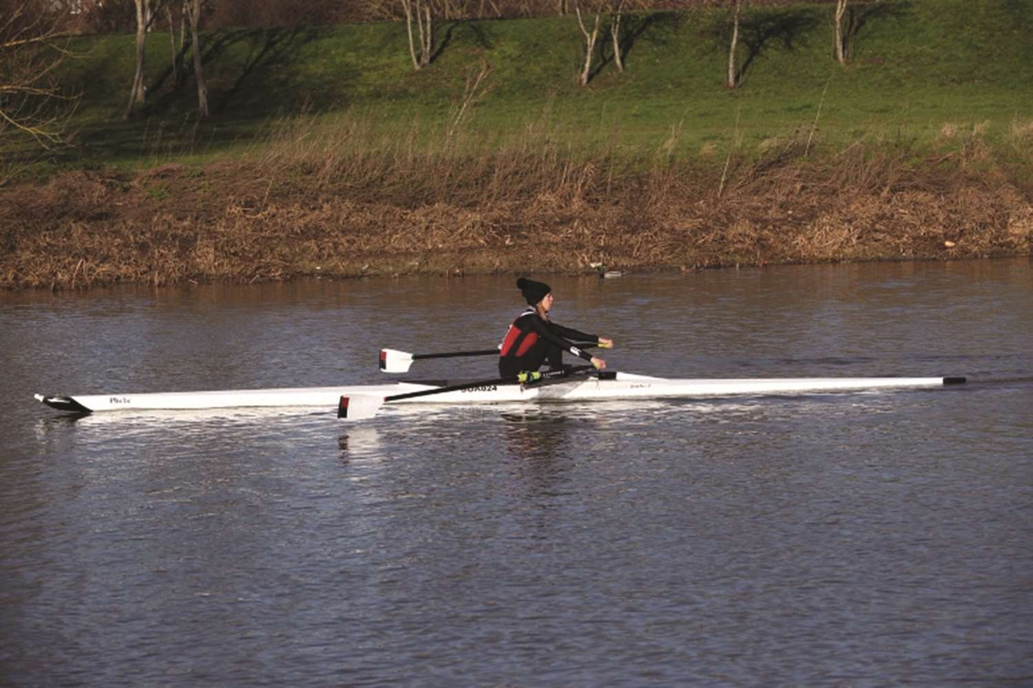Stratford Boat Club's single sculler Heather Hayton powering along the Northampton course.