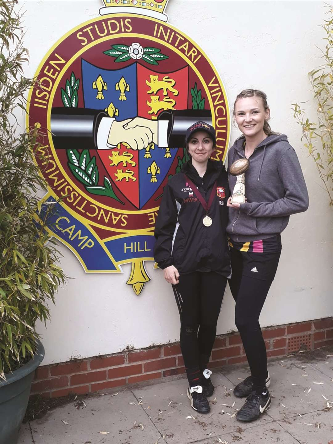 Captain Tasha Rose with the trophy and Wellesbourne's players' player of the tournament, Natalie Monaghan.