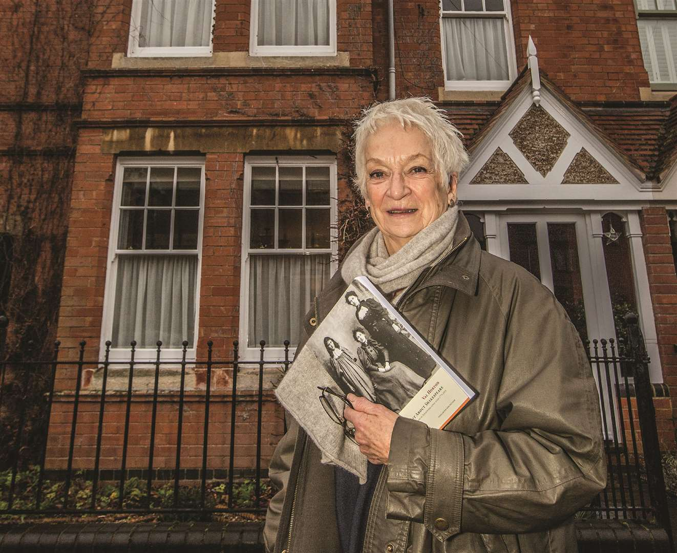 Val Horton with her new book outside the house that started it all. Photo copyright: Mark Williamson/Stratford Herald