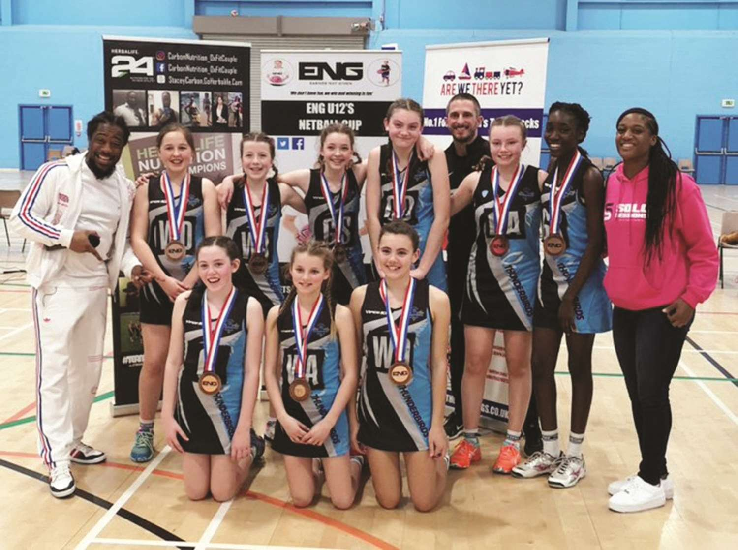The U12A team (in no order) of Isabella Balzaretti, Mollie Hegarty, Charlotte Frank-Steier, Isobel Lock, Sienna Hollier, Abigail Brennan, Hannah Constance, Lara Whitting and Jessica Monthe with England international Sasha Corbin and representatives of ENG Sport UK.