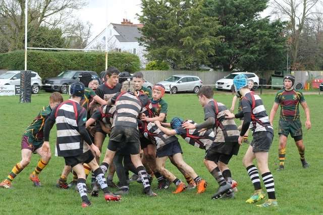Stratford U14s and Old Laurentians scrap for the ball.
